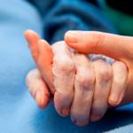 Patient holding hands